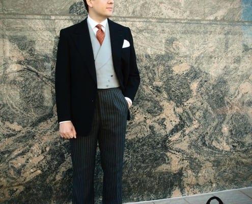 Sven Raphael Schneider in a Stroller Suit with Contrasting Vest