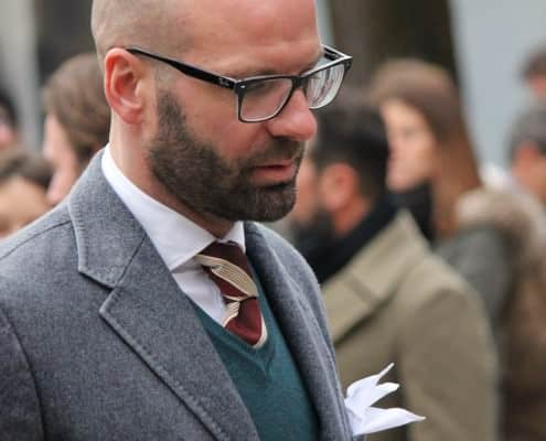 Gray diagonal twill jacket with knit vest and striped silk tie