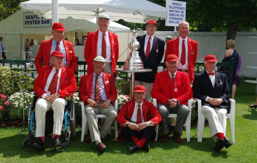 Scarlett red blazers of members of the Lady Margaret Hall Boat Club
