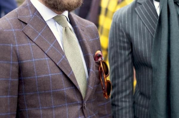 Windowpane suit with green tie and finely striped shirt