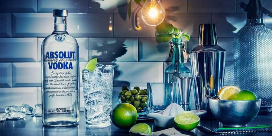 Absolut Vodka Ad with limes, Vodka botttles and bar supplies