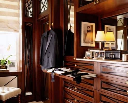 Classic closet with elegant woodwork and many drawers