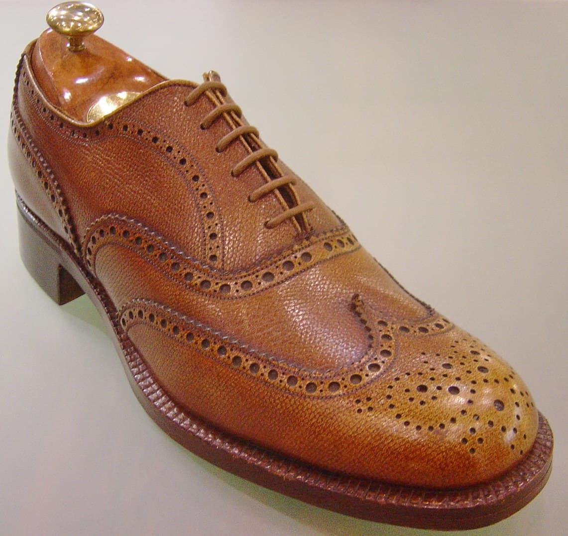 "WE'VE TAKEN BROGUING BACK TO ITS ROOTS Today, we usually see the decorative perforations called ""brogues"" on dress shoes. But they actually originated in the early s in Ireland on outdoor boots to let water to drain when crossing wet terrain."