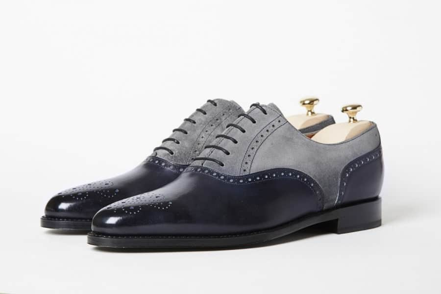 A navy leather and gray suede brogue u-cap variation