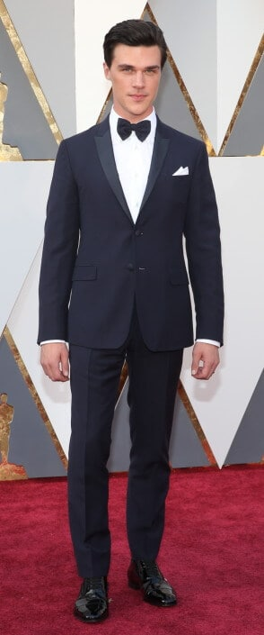 Finn Wittrock with chique bow tie, but two buttons and flaps on jacket - nice wide black tie shoelaces