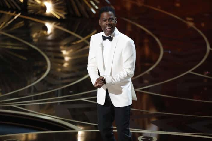 Host Chris Rock win white, double vented dinner jacket and waistcoat inspired shawl collar