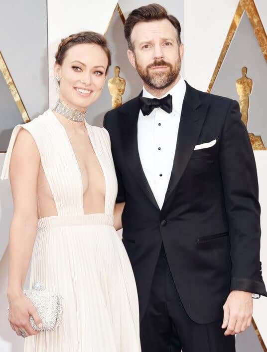 Olivia Wilde and Jason Sudeikis with turndown collar, self tie bow tie, black studs and cuffs - sleeves too long