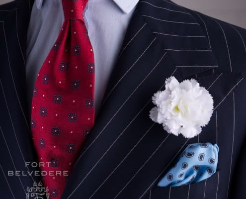 Chalk stripe suit with White Large Carnation, Light Blue Silk Pocket Square and Red Jacquard Tie - all by Fort Belvedere