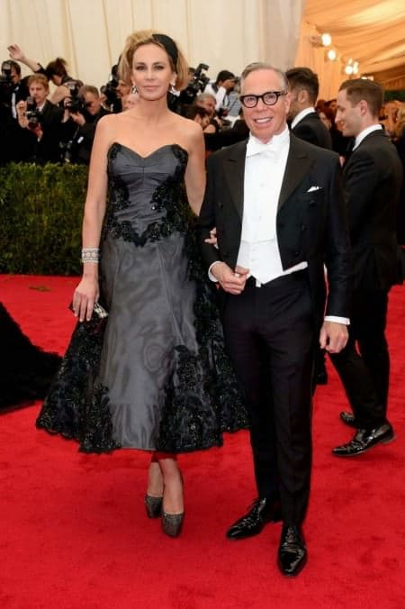 Dee and Tommy Hilfiger at the Met Gala 2014 in a hilfiger white tie ensemble, note how the shirt or waistcoat tab is exposed - a faux pas