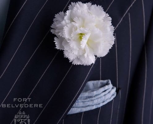 Large White Carnation with Light Blue Textured Linen Pocket Square - by Fort Belvedere