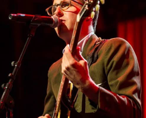 Nick Waterhouse in a green single breasted sport coat