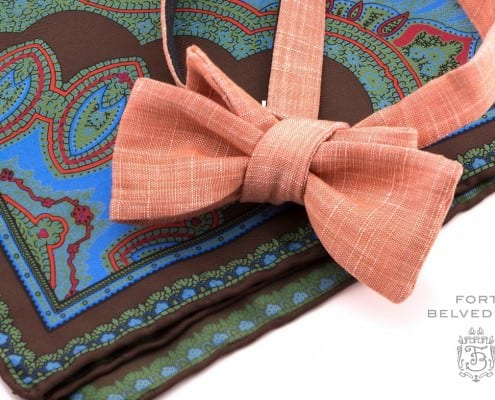 Orange linen bow tie with asymmetrical shape & paisley style brown, blue, red & green pocket square