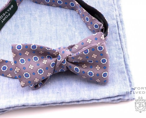 Light brown silk foulard bow tie with textured light blue linen pocket square.