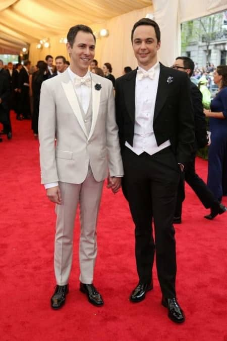 Todd Spiewak & Jim Parsons; left outfit is simply bad. On the right, waistcoat is too long, and obvious fake boutonnieres are bad. Either a real flower, or something that looks real