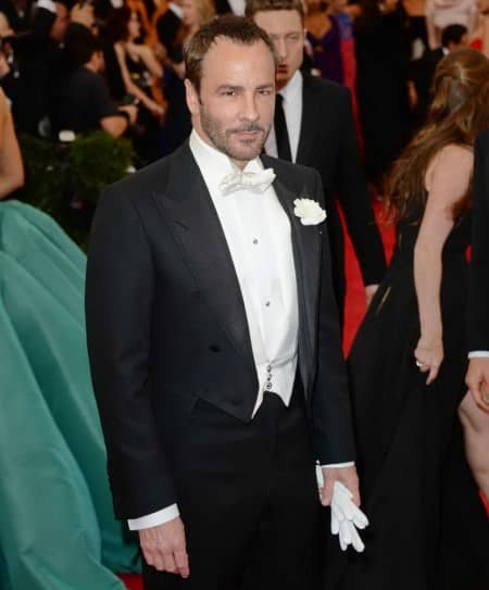 Tom Ford in white tie ensemble with white gloves and boutonniere