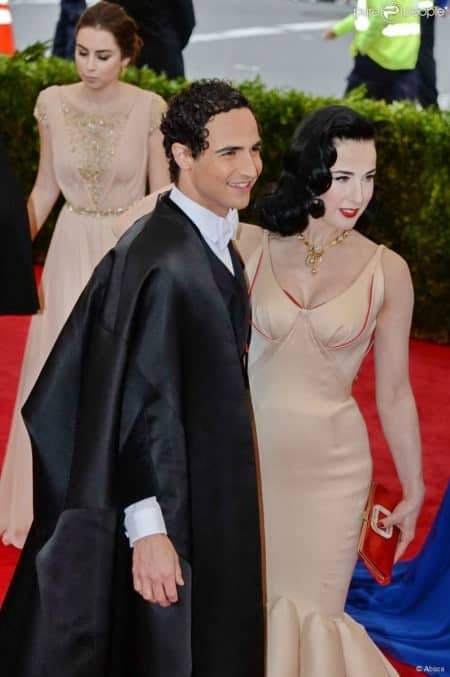 Zac Posen with an evening cape - one of the proper overcoat options for white tie