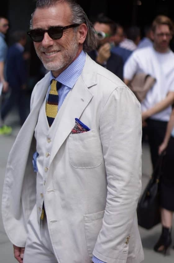 Three piece summer suit with spalla camicia and knit tie that pokes out of underneath the vest