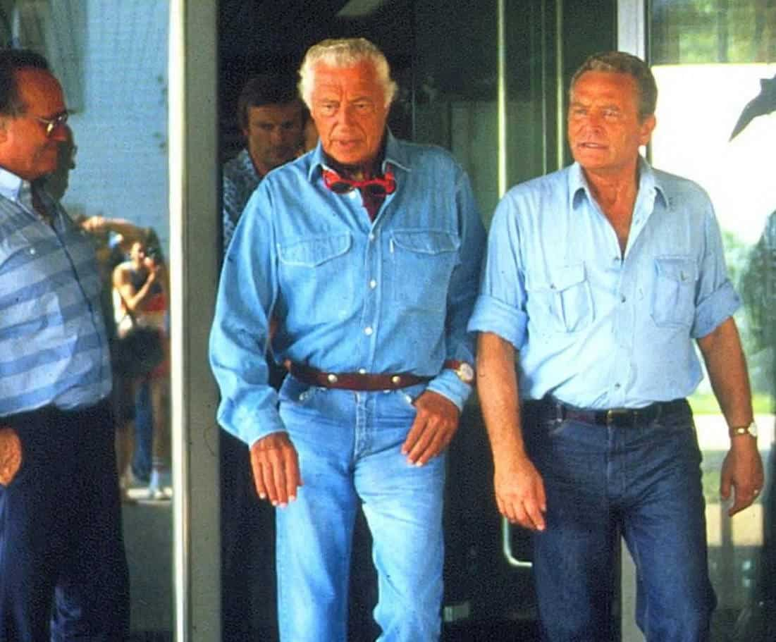 Agnelli in washed denim with watch on top of shirt cuff