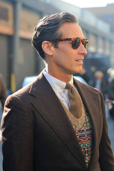 Tortoise Shell sunglasses with fair isle vest and collar pin