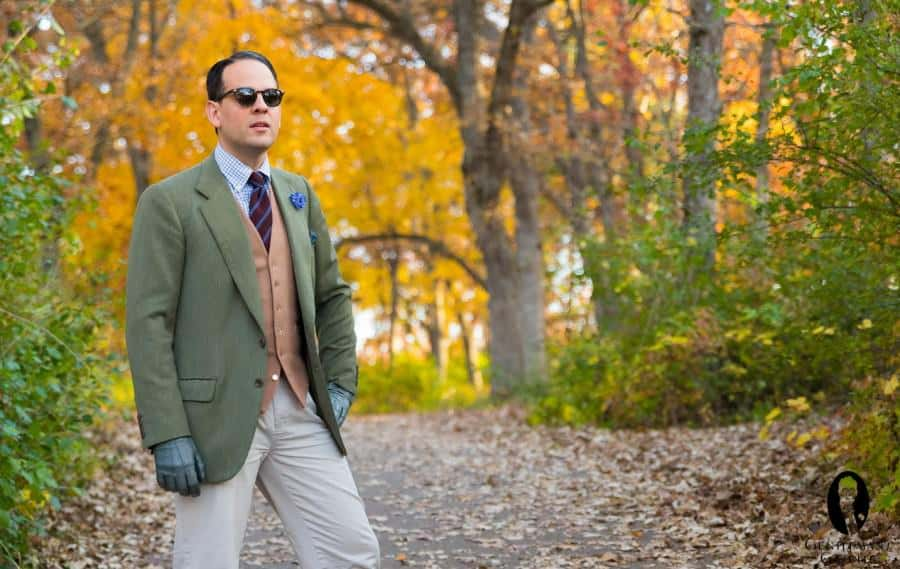Green jacket, camel doeskin vest, striped woll tie, small checked shirt, blue cornflower bz Fort Belvedere