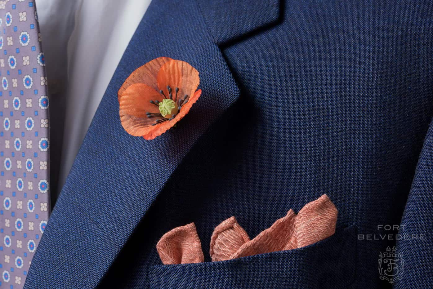 Orange Poppy Boutonniere with linen wool pocket and silk foulard tie all by Fort Belvedere