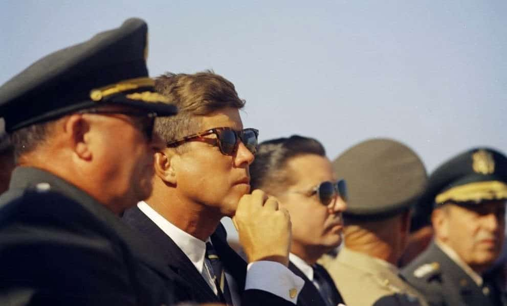 JFK wearing gold cufflinks and tortoiseshell sunglasses