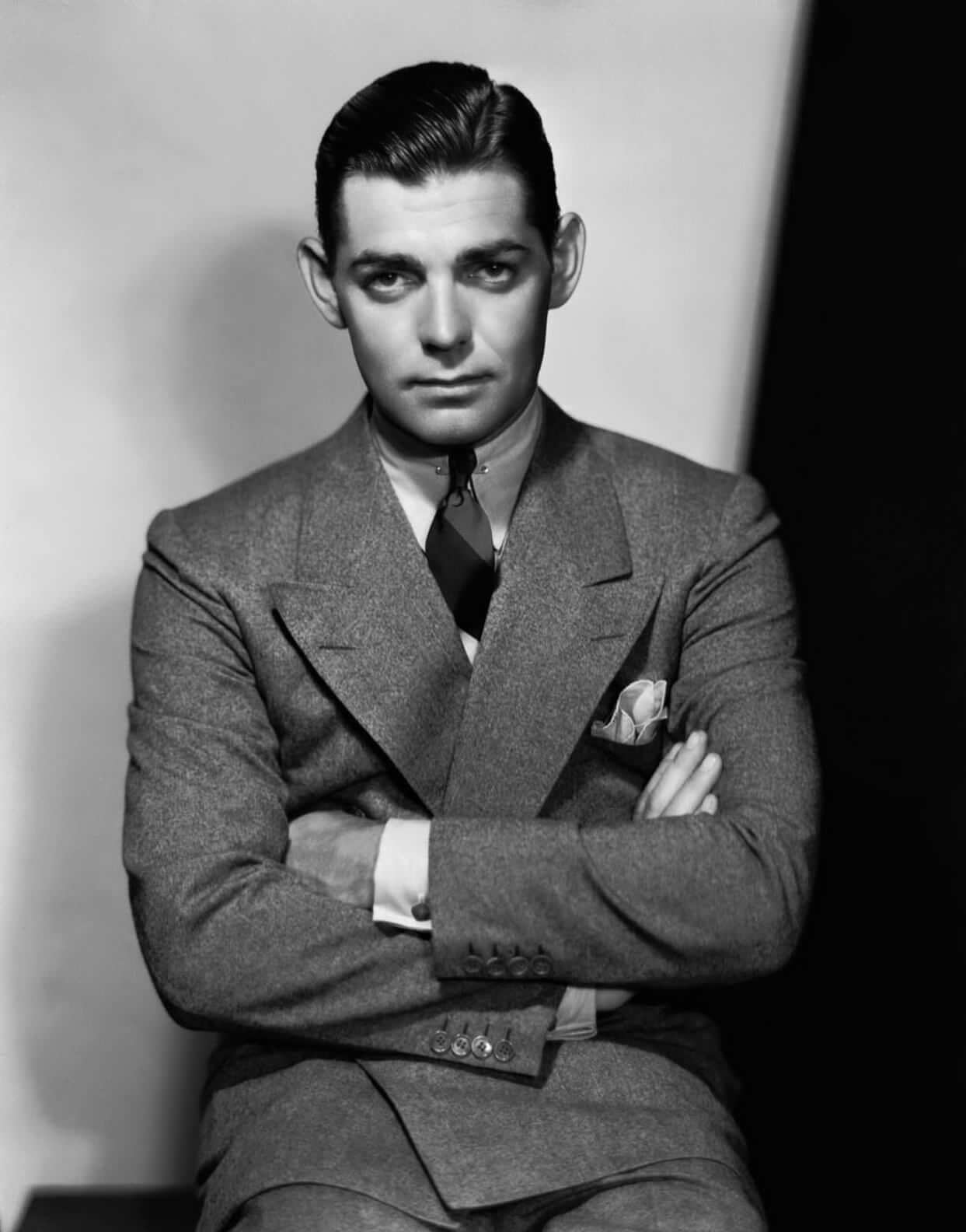 Clark Gable wearing a wide peaked lapel tweed suit