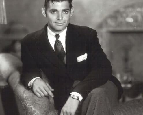 Young Gable with collar pin and bold striped tie