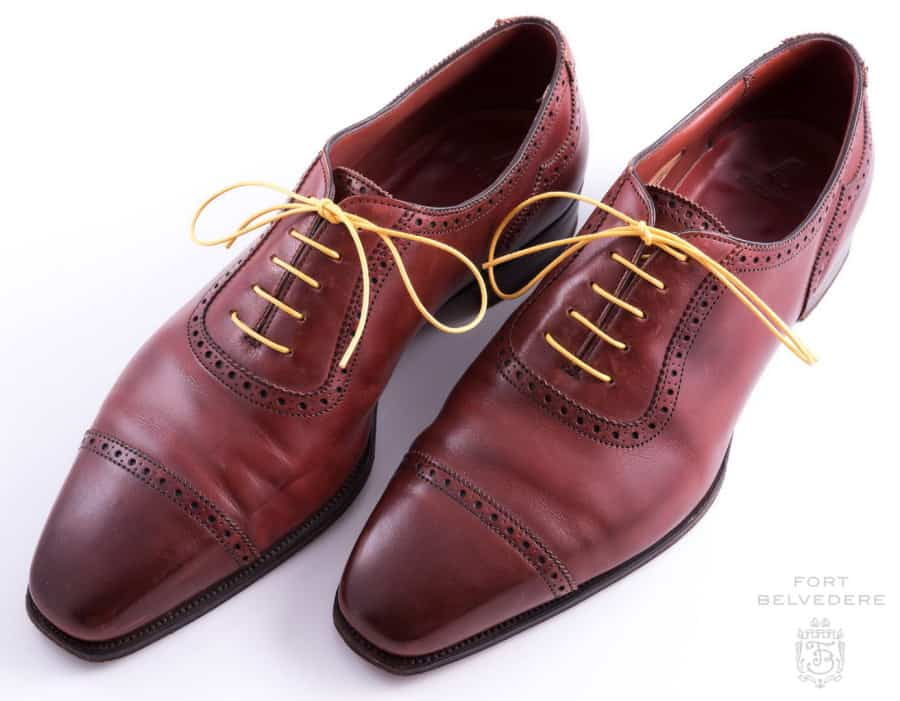Yellow Shoelaces Round Waxed Cotton - Made in Italy by Fort Belvedere in an oxblood oxfords