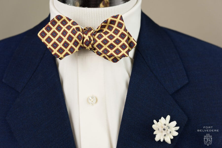 Ancient Madder Silk Bow Tie in Yellow, Red Blue & Orange Diamond Pattern paired with Edelweiss