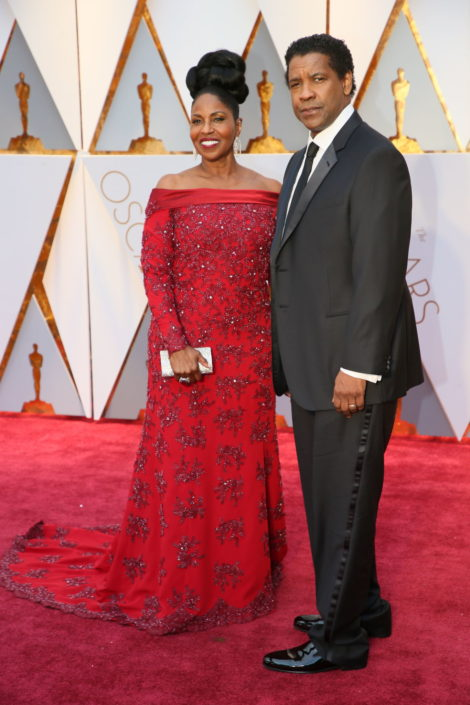Denzel Washington with black necktie and pants that are way too long