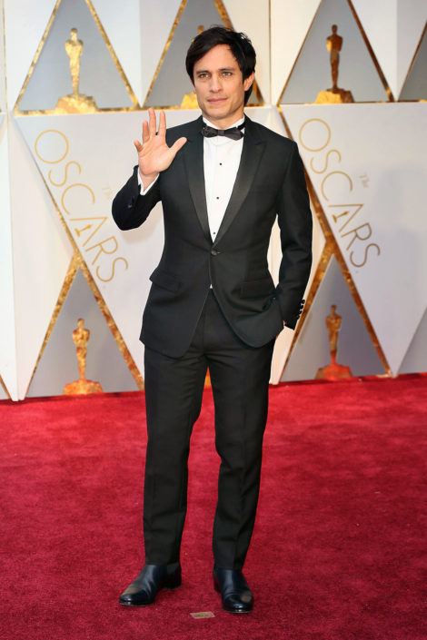 Gael García Bernal wearing Dior Homme tux with flap pockets without pocket sqaure and slim diamond bow tie without cummerbund but with Chelsea boots