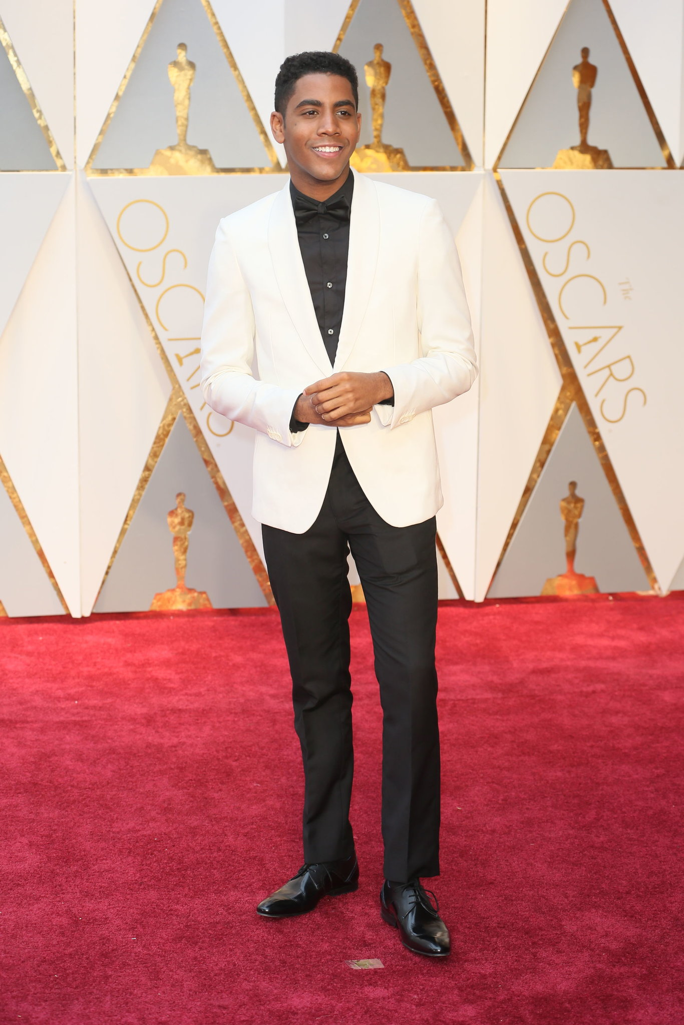 Jharrel-Jerome-in-white-dinner-jacket -withou-pocket-square-and-black-shirt-with-pre-tied-bow-tie.jpg c9fd28da24a