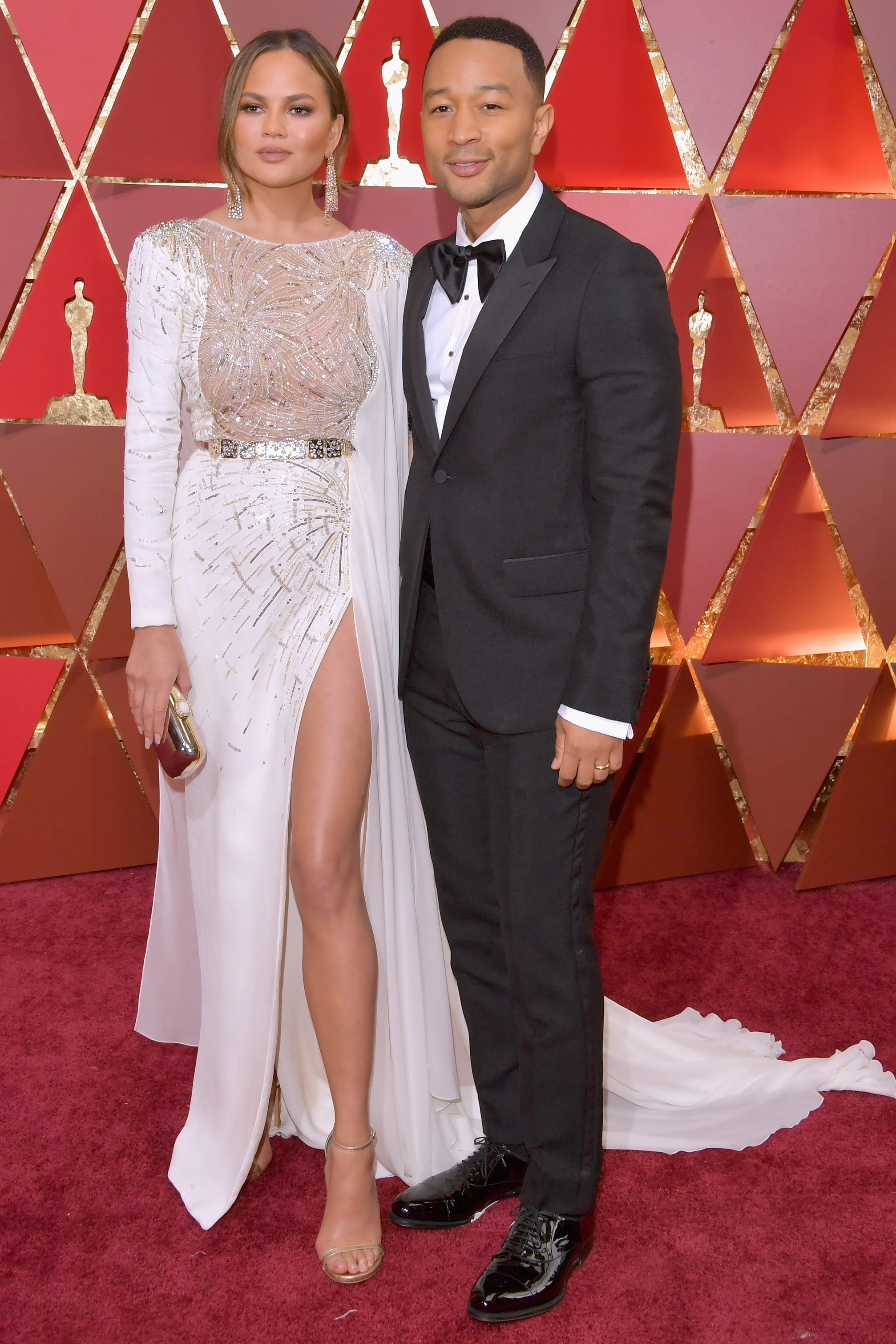 3a73061470 John-Legend-wearing-a-70s-inspired-huge -floppy-bow-tie-with-peaked-lapel-1-button-tux-with-flap-pockets-and-patent-leather-captoe-Oxfords.jpg