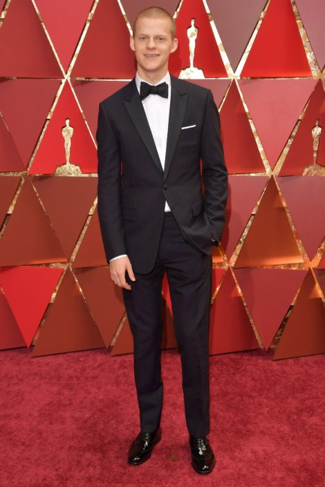 Lucas Hedges in Dior Homme tux with flaps, interesting bow tie but without cummerbund