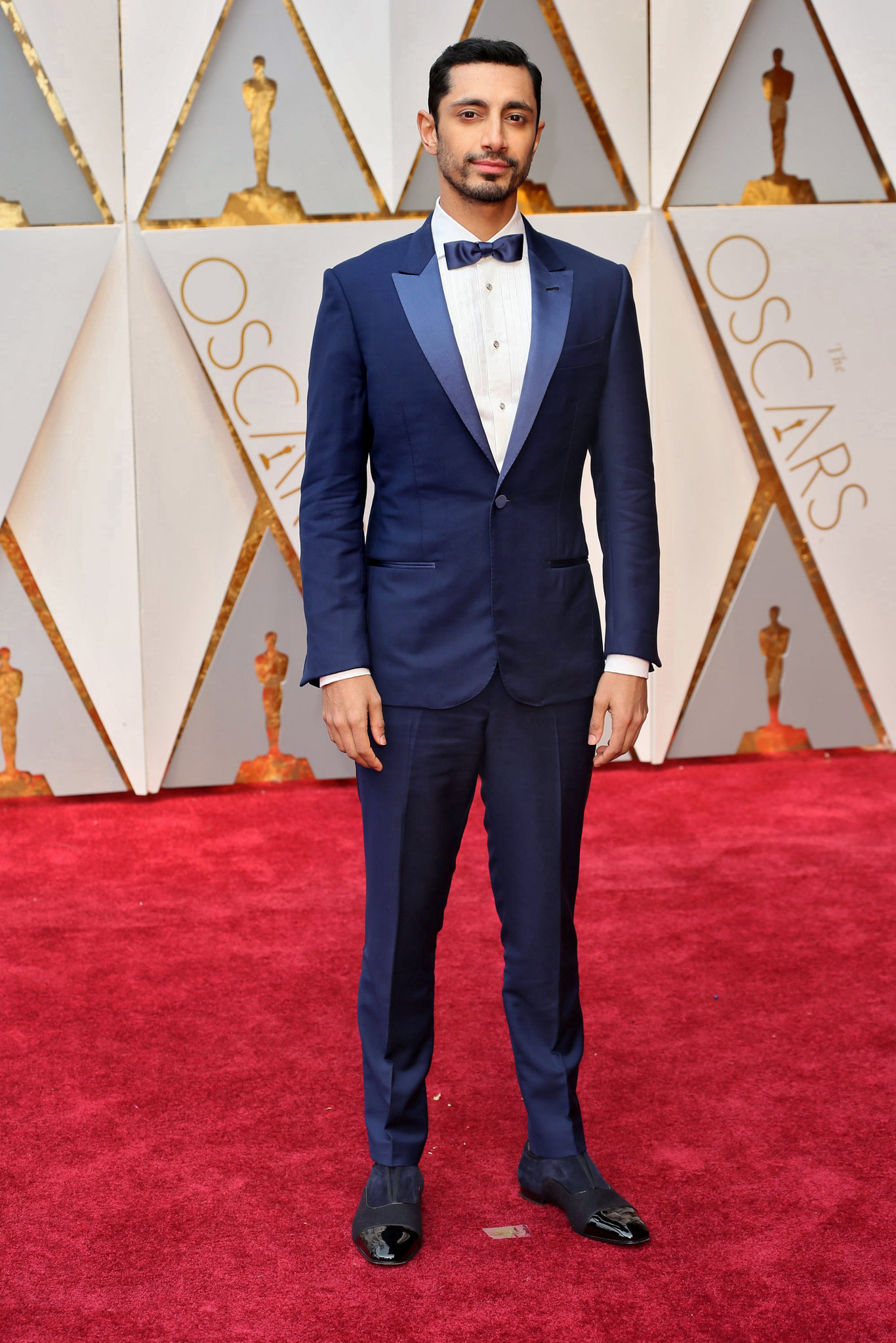 7fd3ded64c9 Riz-Ahmed-in-navy-blue-tuxedo-with-navy-satin-bow-tie-and-blue-black-suede- shoes.jpg