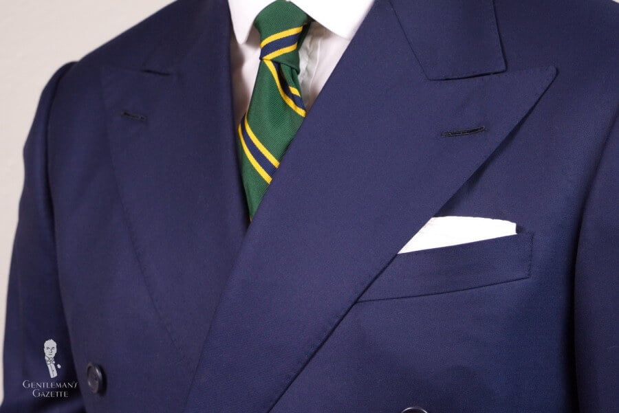 Dark Navy Suit with striped tie and TV fold pocket square
