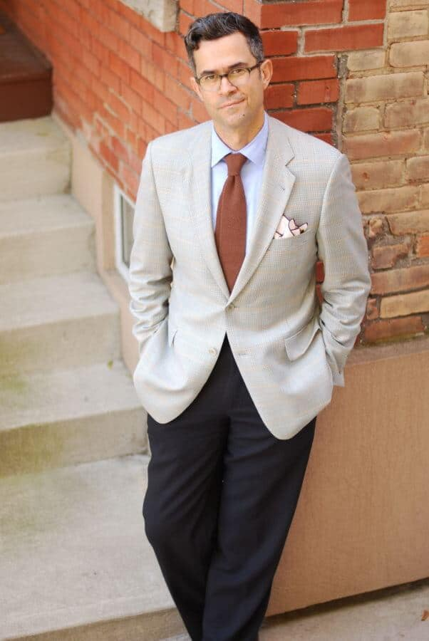 Hogtownrake in combination of light sport coat with charcoal pants and brown wool knit tie, blue shirt and cream pocket square