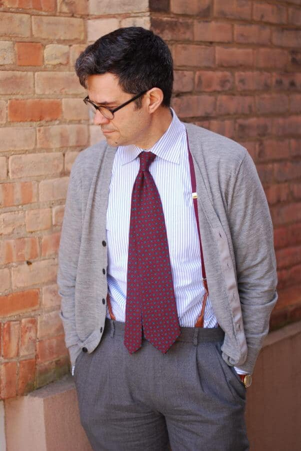 Madder inspired tie that extends beyond the waistband with suspenders, cardigan and vintage watch