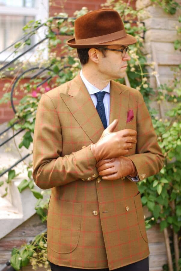 Pedro pulling off a velour hat, bold sportcoat, silk knit tie and light blue shirt. Note the plain back gloves in brown