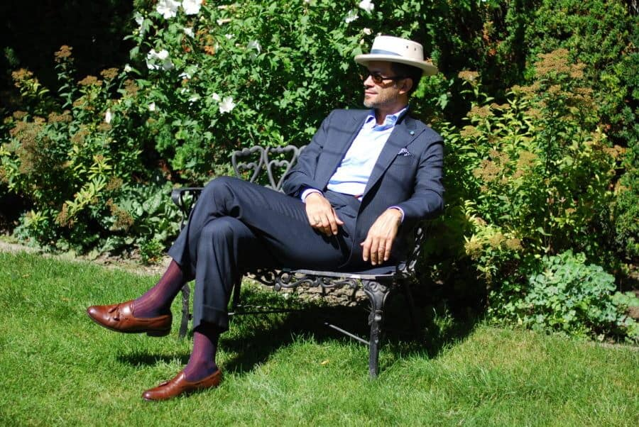 Pedro with grey blue checked suit, shadow stripe socks in red and blue, brown tassels and planter inspired off white hat with folded blue hat band
