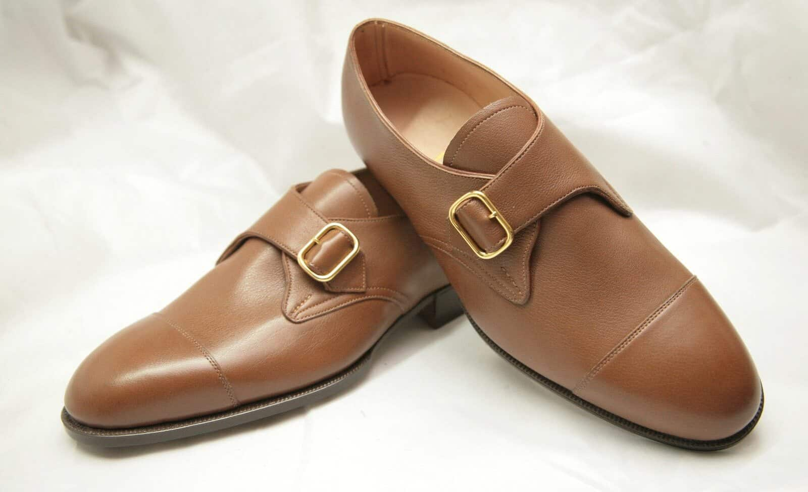 History of Monk Strap Shoes. As with many clothing items, the exact origins of the monk strap are unclear. According to some, it was aptly named, after a monk from the Alps who created a special form of sandals in the 15th century.