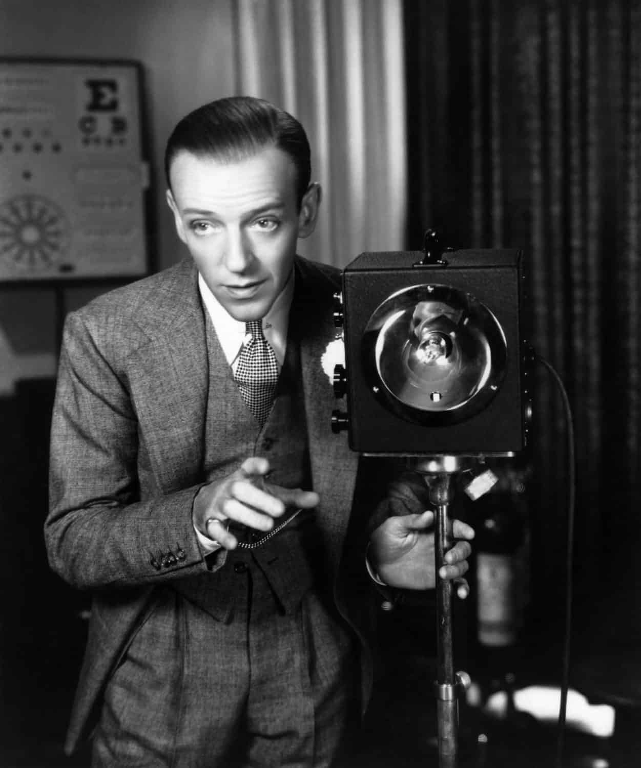 Fred Astaire with collar pin but no tie bar when he wears a three piece suit or vest