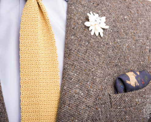Tweed sport coat with buff rabbits on navy silk wool-pocket square by Fort Belvedere
