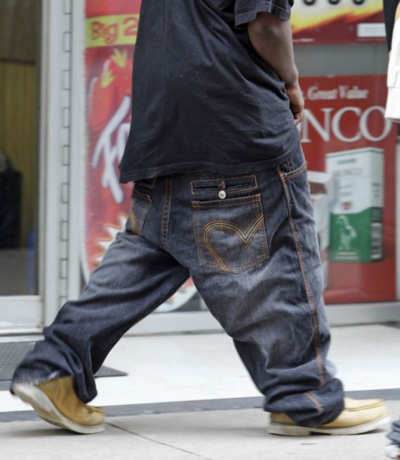 An older man wearing baggy and sagging jeans