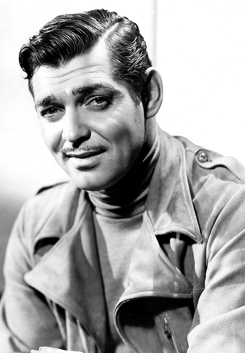 Clark Gable wearing an overcoat with a turtleneck sweater