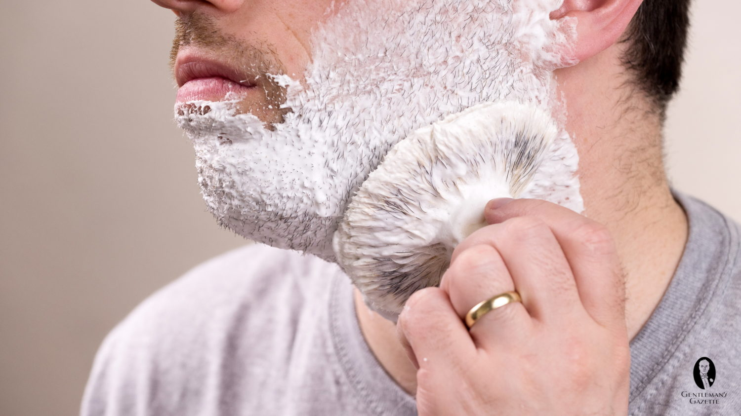 Applying lather to the face with a brush in a circular motion