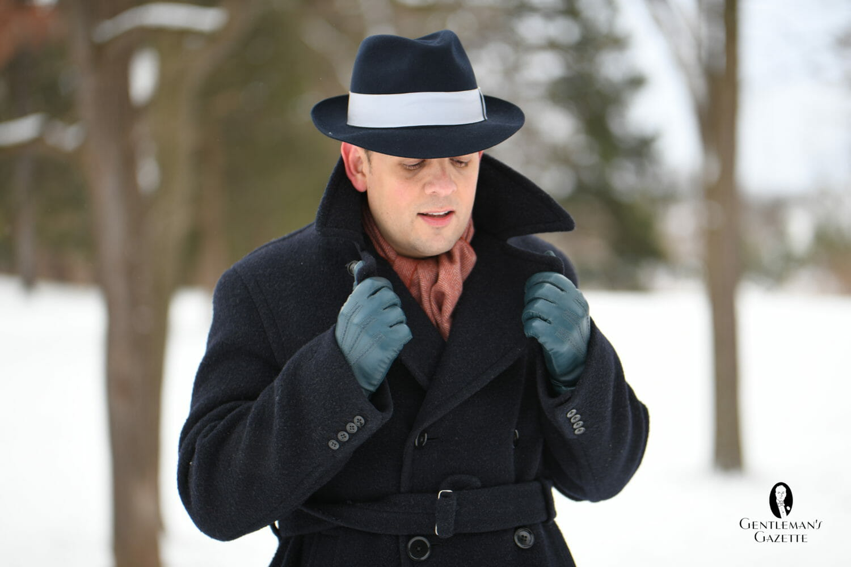 Raphael looking dapper wearing petrol blue gloves from Fort Belvedere