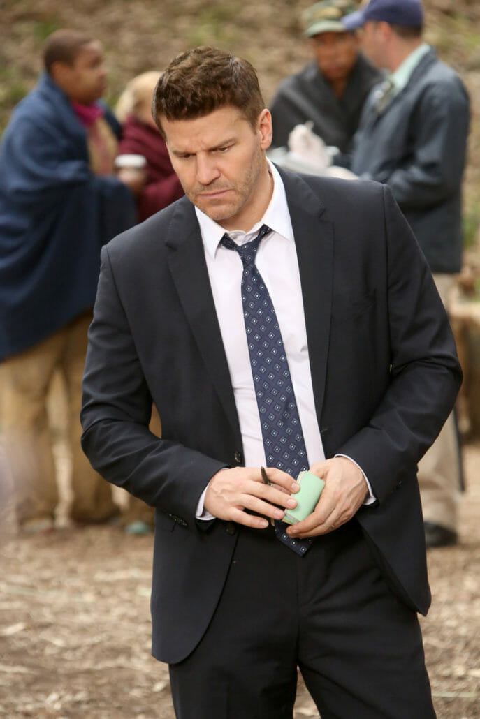 FBI agent Seely Booth, on the TV show Bones, often wore his top shirt button open with a loosened tie.