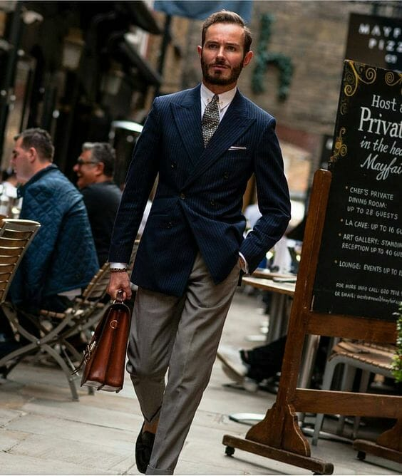 Blue blazer with gray trousers